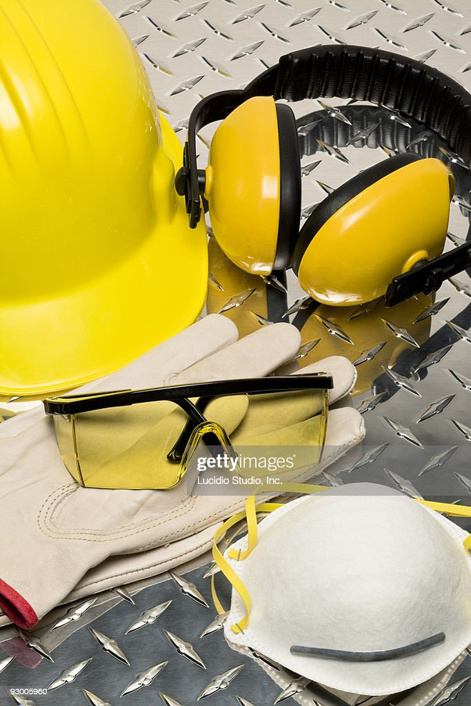 Safety items including hard hat, glasses, gloves, : Stock Photo