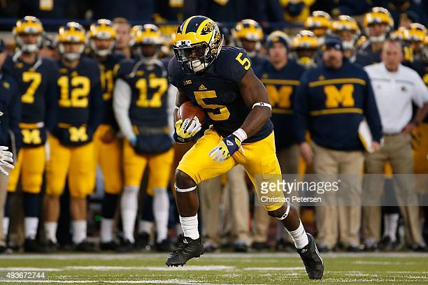 Safety Jabrill Peppers of the Michigan Wolverines runs with the football during the college football game against the Michigan State Spartans at...