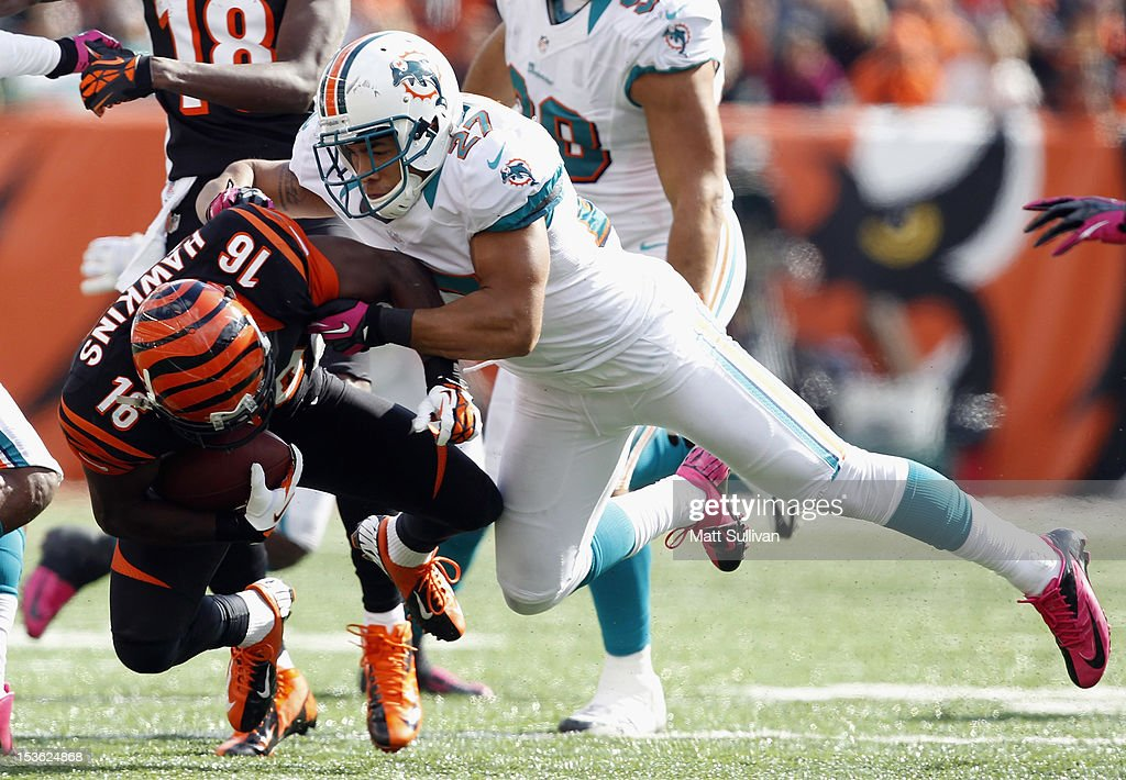 Safety Jimmy Wilson #27 of the Miami Dolphins hits wide receiver <a gi-track='captionPersonalityLinkClicked' href=/galleries/search?phrase=Andrew+Hawkins&family=editorial&specificpeople=6365500 ng-click='$event.stopPropagation()'>Andrew Hawkins</a> #16 of the Cincinnati Bengals at Paul Brown Stadium on October 7, 2012 in Cincinnati, Ohio.