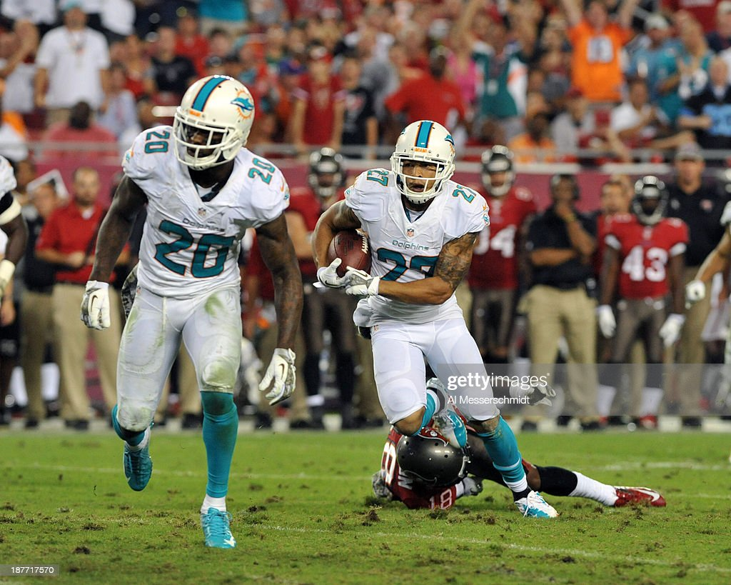 Safety Jimmy Wilson #27 of the Miami Dolphins runs upfield with an interception against the Tampa Bay Buccaneers November 11, 2013 at Raymond James Stadium in Tampa, Florida. Tampa won 22 - 19.