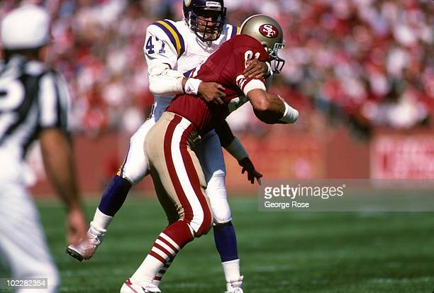 Safety Joey Browner of the Minnesota Vikings tackles tight end Russ Francis of the San Francisco 49ers during a game at Candlestick Park on October...