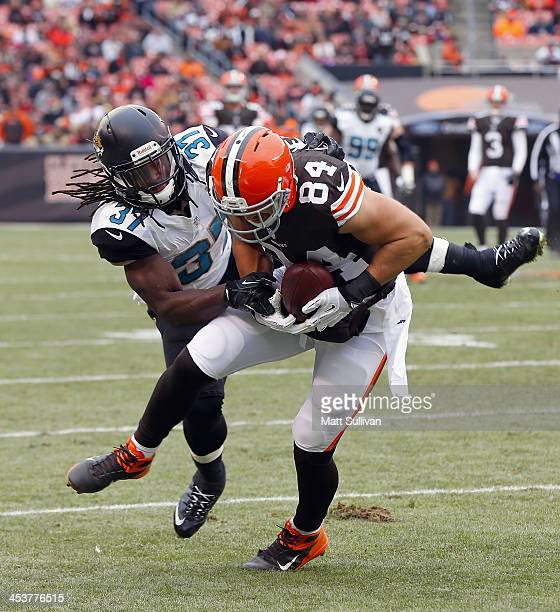 Safety Johnathan Cyprien of the Jacksonville Jaguars tackles tight end Jordan Cameron of the Cleveland Browns at FirstEnergy Stadium on December 1...