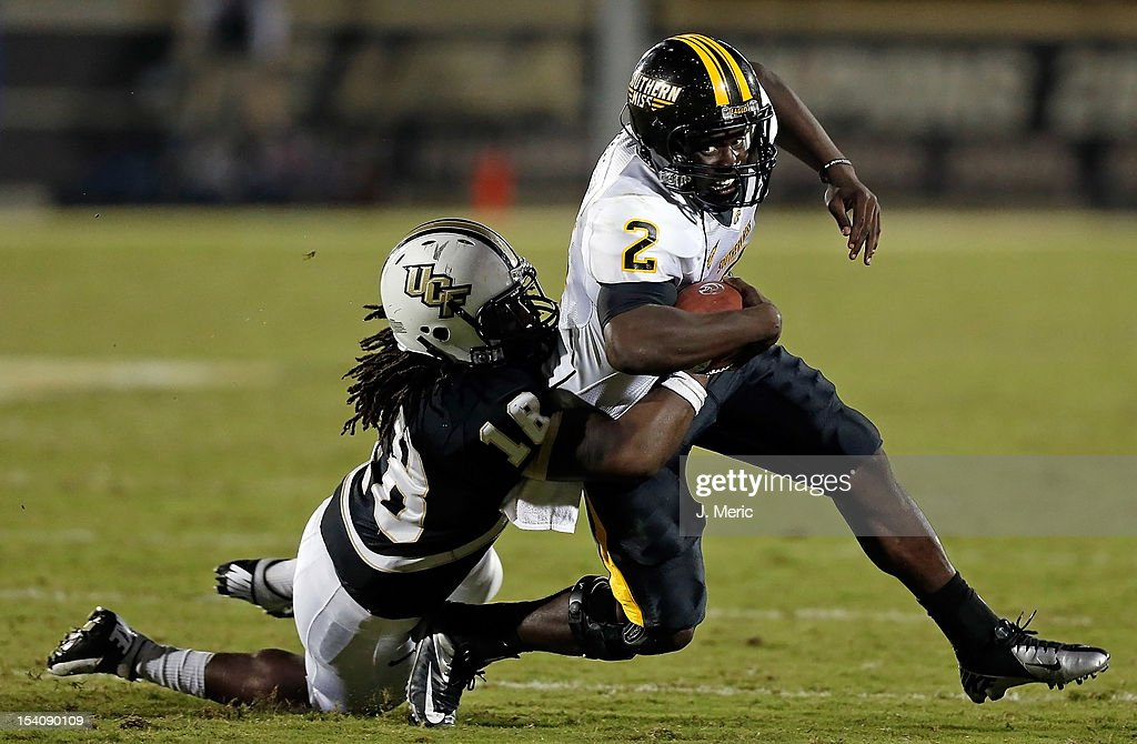 Safety Kemal Ishmael #18 of the Central Florida Knights tackles quarterback Anthony Alford #2 of the Southern Mississippi Golden Eagles during the game at Bright House Networks Stadium on October 13, 2012 in Orlando, Florida.