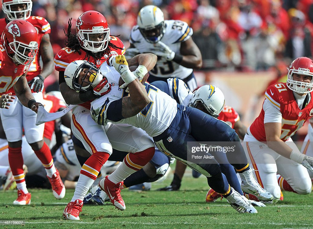 Safety <a gi-track='captionPersonalityLinkClicked' href=/galleries/search?phrase=Kendrick+Lewis&family=editorial&specificpeople=4501037 ng-click='$event.stopPropagation()'>Kendrick Lewis</a> #23 of the Kansas City Chiefs tackles running back <a gi-track='captionPersonalityLinkClicked' href=/galleries/search?phrase=Ryan+Mathews+-+American+Football+Player&family=editorial&specificpeople=2082832 ng-click='$event.stopPropagation()'>Ryan Mathews</a> #24 of the San Diego Chargers during the first half on November 24, 2013 at Arrowhead Stadium in Kansas City, Missouri.