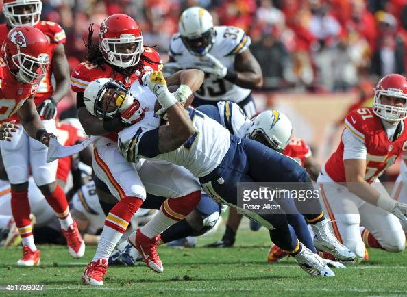 Safety Kendrick Lewis of the Kansas City Chiefs tackles running back Ryan Mathews of the San Diego Chargers during the first half on November 24 2013...