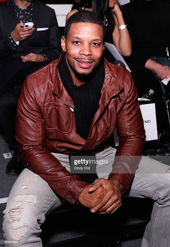 NFL safety <a gi-track='captionPersonalityLinkClicked' href=/galleries/search?phrase=Kerry+Rhodes&family=editorial&specificpeople=567200 ng-click='$event.stopPropagation()'>Kerry Rhodes</a> attends the B Michael America Fall 2013 fashion show during Mercedes-Benz Fashion Week at The Studio at Lincoln Center on February 13, 2013 in New York City.