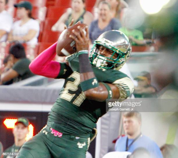 Safety Khalid McGee of the South Florida Bulls catches the ball during warmups before their game against the Cincinnati Bearcats at Raymond James...