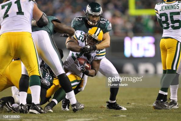 Safety Kurt Coleman of the Philadelphia Eagles tackles running back Brandon Jackson of the Green Bay Packers during a wildcard playoff game at...