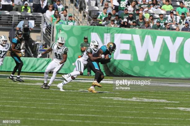 Safety Marcus Maye of the New York Jets makes a stop against the Jacksonville Jaguars during their game at MetLife Stadium on October 1 2017 in East...