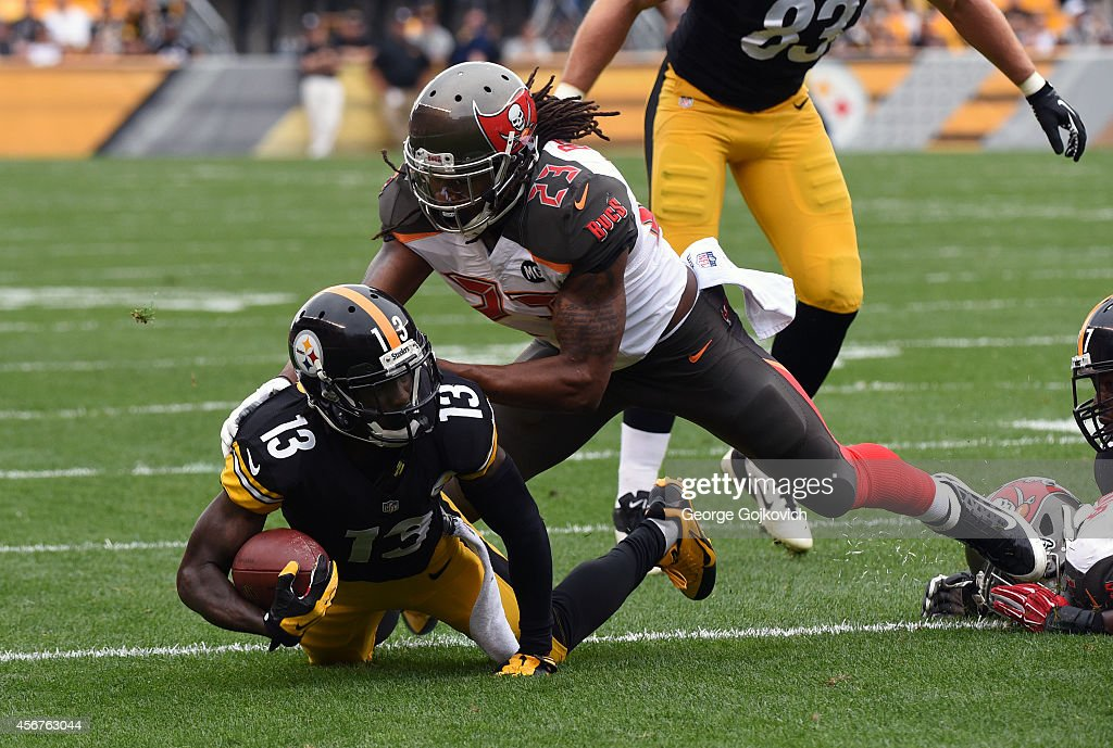 Safety <a gi-track='captionPersonalityLinkClicked' href=/galleries/search?phrase=Mark+Barron&family=editorial&specificpeople=2593511 ng-click='$event.stopPropagation()'>Mark Barron</a> #23 of the Tampa Bay Buccaneers tackles running back <a gi-track='captionPersonalityLinkClicked' href=/galleries/search?phrase=Dri+Archer&family=editorial&specificpeople=9689813 ng-click='$event.stopPropagation()'>Dri Archer</a> #13 of the Pittsburgh Steelers during a game at Heinz Field on September 28, 2014 in Pittsburgh, Pennsylvania. The Buccaneers defeated the Steelers 27-24.