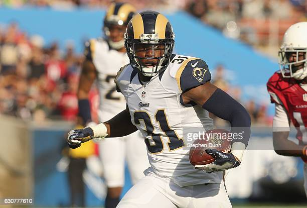 Safety Maurice Alexander of the Los Angeles Rams returns his pass interception against the Arizona Cardinals in the second quarter at Los Angeles...