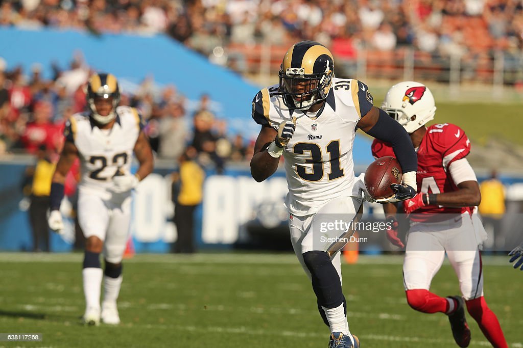 Safety Maurice Alexander #31 of the Los Angeles Rams returns his pass interception against the Arizona Cardinals in the second quarter at Los Angeles Memorial Coliseum on January 1, 2017 in Los Angeles, California.
