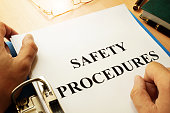 Safety procedures in a blue folder. Work Safety concept.