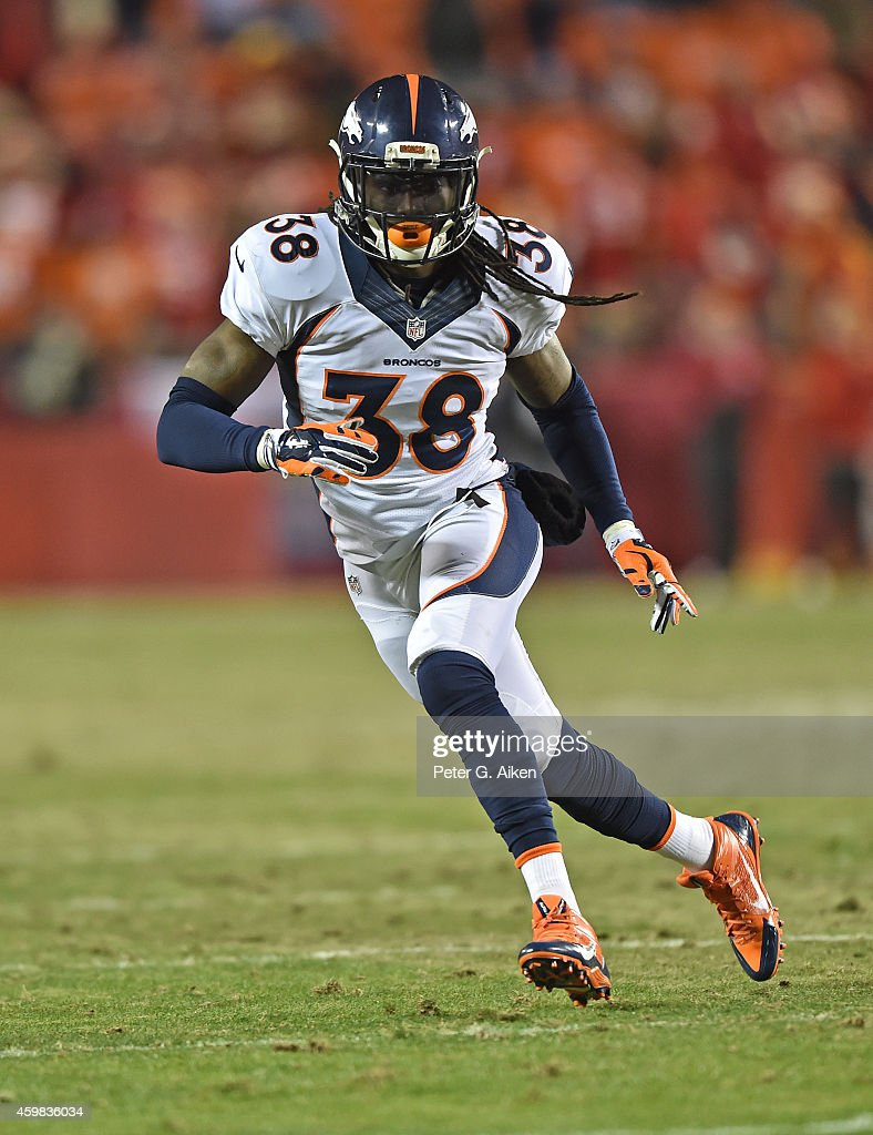 Safety <a gi-track='captionPersonalityLinkClicked' href=/galleries/search?phrase=Quinton+Carter&family=editorial&specificpeople=5631827 ng-click='$event.stopPropagation()'>Quinton Carter</a> #38 of the Denver Broncos gets set on defense against the Kansas City Chiefs during the second half on November 30, 2014 at Arrowhead Stadium in Kansas City, Missouri.