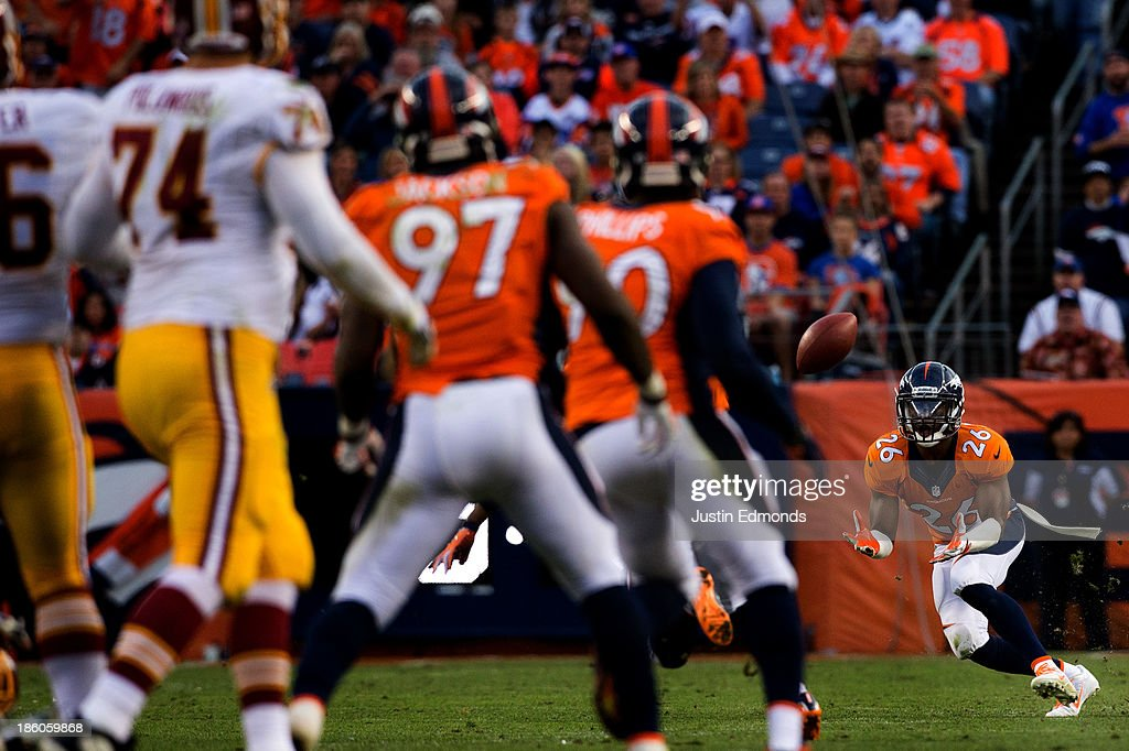 Safety <a gi-track='captionPersonalityLinkClicked' href=/galleries/search?phrase=Rahim+Moore&family=editorial&specificpeople=5510817 ng-click='$event.stopPropagation()'>Rahim Moore</a> #26 of the Denver Broncos makes an interception on a pass thrown by quarterback <a gi-track='captionPersonalityLinkClicked' href=/galleries/search?phrase=Robert+Griffin&family=editorial&specificpeople=2495030 ng-click='$event.stopPropagation()'>Robert Griffin</a> III #10 of the Washington Redskins (not pictured) during the fourth quarter at Sports Authority Field Field at Mile High on October 27, 2013 in Denver, Colorado. The Broncos defeated the Redskins 45-21.