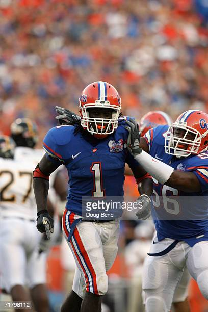 Safety Reggie Nelson and linebacker Darryon Robinson of the University of Florida Gators celebrate a play during the game against the Southern Miss...
