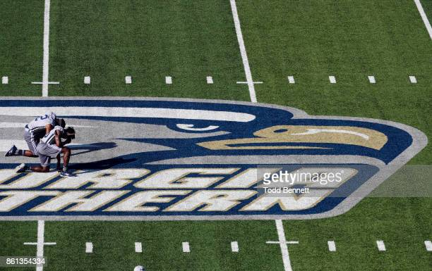 Safety RJ Murray and safety Jay Bowdry of the Georgia Southern Eagles pray at mid field before their game against the New Mexico State Aggies at...