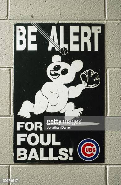 A safety sign warning of foul balls at Wrigley Field on June 15 2004 in Chicago Illinois