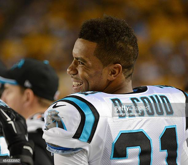 Safety Thomas DeCoud of the Carolina Panthers smiles as he looks on from the sideline during a preseason game against the Pittsburgh Steelers at...