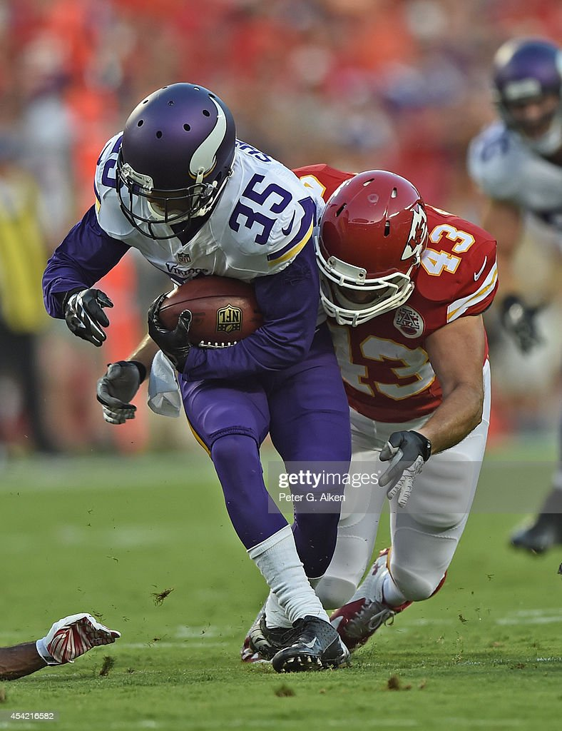 Safety Thomas Gafford of the Kansas City Chiefs tackles kick returner Marcus Sherels of the Minnesota Vikings during the first half on August 23 2014...
