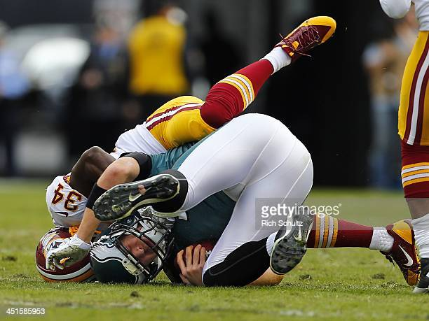 Safety Trenton Robinson of the Washington Redskins tackles quarterback Nick Foles of the Philadelphia Eagles during a game as the Eagles defeated the...
