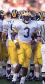 Safety Tripp Welbourne of the University of Michigan Wolverines carries the ball during a September 1989 game