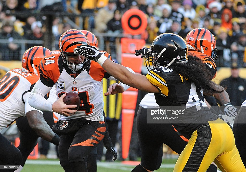 Safety Troy Polamalu #43 of the Pittsburgh Steelers sacks quarterback Andy Dalton #14 of the Cincinnati Bengals during a game at Heinz Field on December 23, 2012 in Pittsburgh, Pennsylvania. The Bengals defeated the Steelers 13-10.