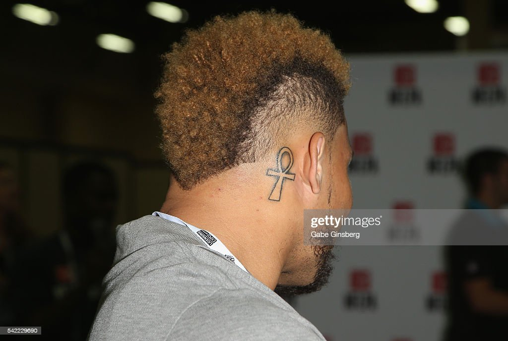Safety Tyrann Mathieu hair tattoo detail of the Arizona Cardinals interacts with fans at the NFLPA Sports Activation Zone during the Licensing Expo...