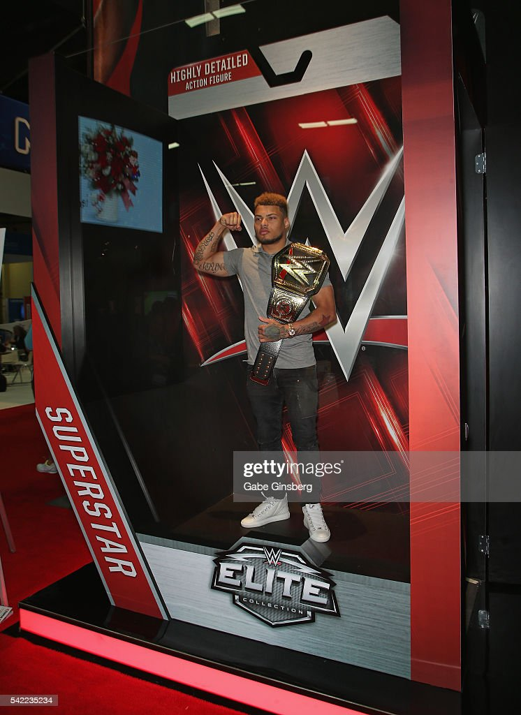 Safety Tyrann Mathieu of the Arizona Cardinals poses in the lifesized action figure packaging display at the WWE booth during the Licensing Expo 2016...