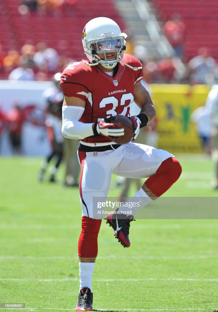 Safety Tyrann Mathieu of the Arizona Cardinals warms up for play against the Tampa Bay Buccaneers September 29 2013 at Raymond James Stadium in Tampa...