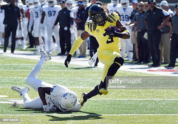 Safety Tyree Robinson of the Oregon Ducks avoids the tackle of wide receiver Penny Hart of the Georgia State Panthers as he runs back an interception...