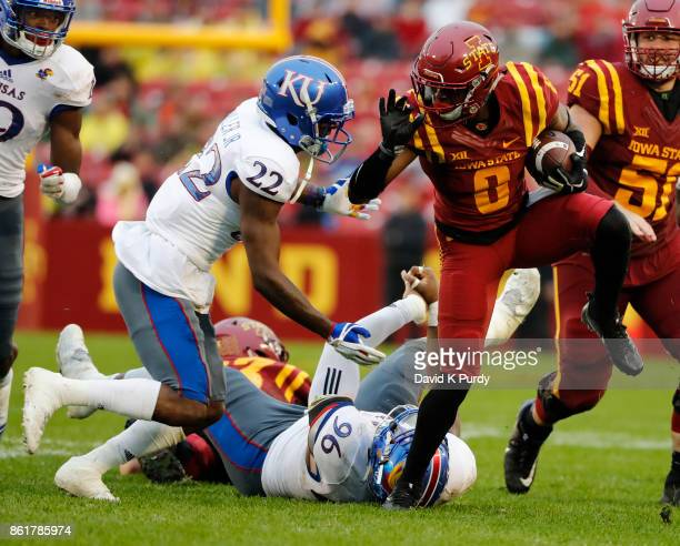 Safety Tyrone Miller Jr #22 of the Kansas Jayhawks tackles wide receiver Deshaunte Jones of the Iowa State Cyclones as he rushed for yards in the...