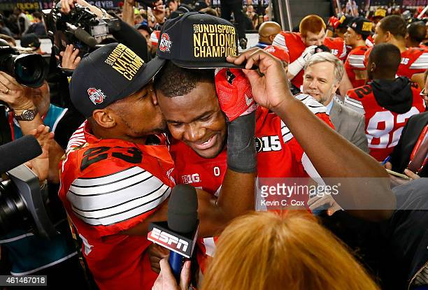 Safety Tyvis Powell and Quarterback Cardale Jones of the Ohio State Buckeyes celebrate after defeating the Oregon Ducks 42 to 20 in the College...