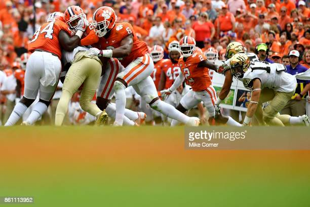 Safety Van Smith linebacker Dorian O'Daniel and linebacker Kendall Joseph of the Clemson Tigers tackle a Wake Forest Demon Deacon during the football...