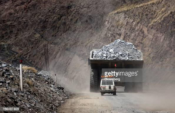 A safety vehicle follows a mining truck loaded with excavated kimberlite rock out of Jwaneng mine operated by the Debswana Diamond Co a joint venture...