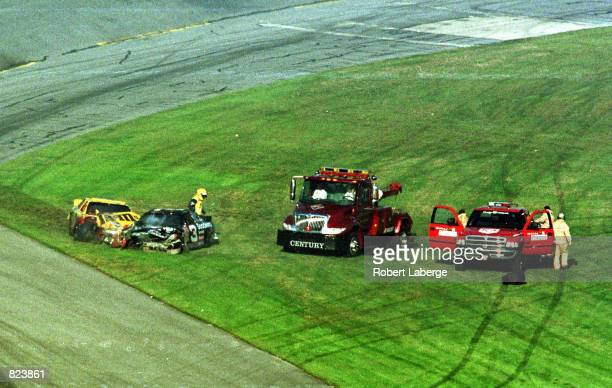 Safety vehicles arrive on the scene of the fatal crash involving Dale Earnhardt and Ken Schrader during the NASCAR Winston Cup Daytona 500 race...