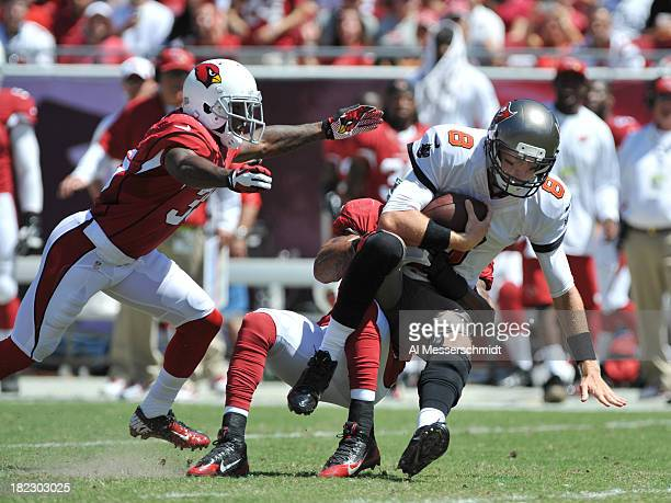 Safety Yeremiah Bell of the Arizona Cardinals sacks quarterback Mike Glennon of the Tampa Bay Buccaneers September 29 2013 at Raymond James Stadium...