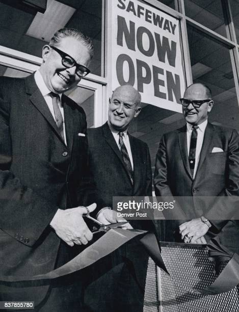 Safeway Store Opens William McNichols manager of public works and repre­senting Mayor Tom Currigan cuts the ribbon Monday morning to open a Safeway...