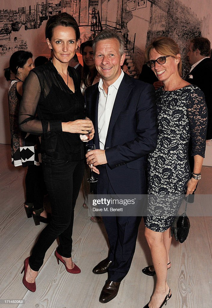<a gi-track='captionPersonalityLinkClicked' href=/galleries/search?phrase=Saffron+Aldridge&family=editorial&specificpeople=208837 ng-click='$event.stopPropagation()'>Saffron Aldridge</a> (L) and guests attend the 'Arts For Life' charity auction hosted by Susan Hayden, Nadja Swarovski and Natalia Vodianova to raise funds for Borne, a research programme on premature birth, at the Saatchi Gallery on June 24, 2013 in London, England.