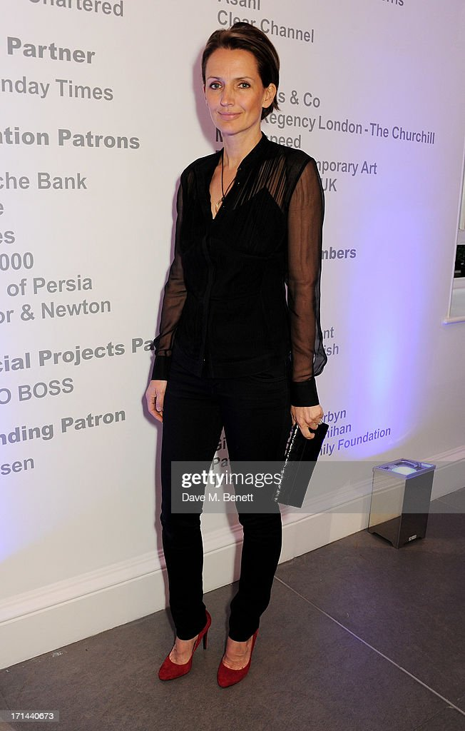 <a gi-track='captionPersonalityLinkClicked' href=/galleries/search?phrase=Saffron+Aldridge&family=editorial&specificpeople=208837 ng-click='$event.stopPropagation()'>Saffron Aldridge</a> attends the 'Arts For Life' charity auction hosted by Susan Hayden, Nadja Swarovski and Natalia Vodianova to raise funds for Borne, a research programme on premature birth, at the Saatchi Gallery on June 24, 2013 in London, England.
