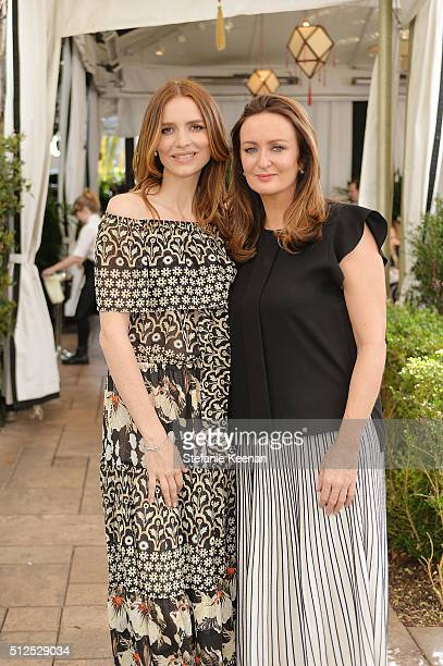 Saffron Burrows and Lucy Yeomans attend NETAPORTER Celebrates Women Behind The Lens at Chateau Marmont on February 26 2016 in Los Angeles California