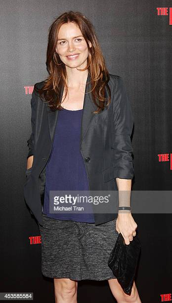Saffron Burrows arrives at the Los Angeles premiere of 'The November Man' held at TCL Chinese Theatre on August 13 2014 in Hollywood California