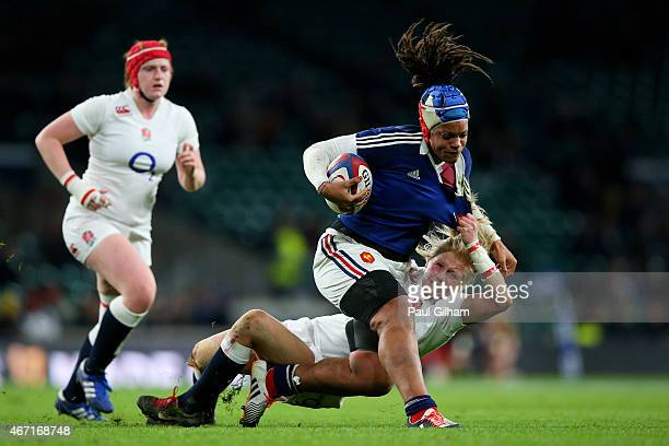Safi N'Diaye of France is hauled down by Alexandra Matthews of England during the Women's Six Nations match between England and France at Twickenham...