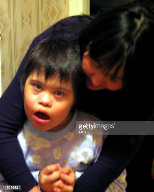 Safia Skaripova comforts her son 8yearold Misha at her small apartment in southern Russia March 22 2004 She claims her exposure to radiation caused...