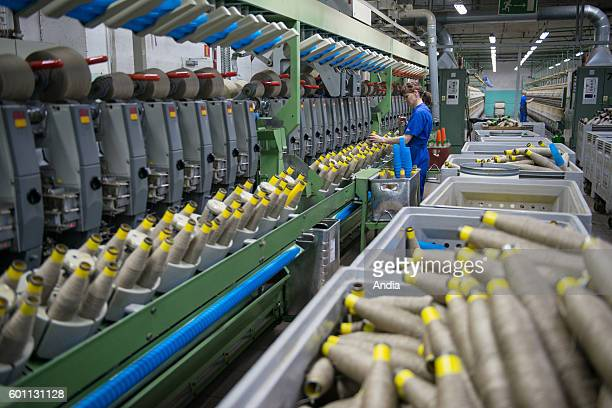 Safilin company specialized in flax weaving in Milakomo Poland Woman working in a spinning mill using reels