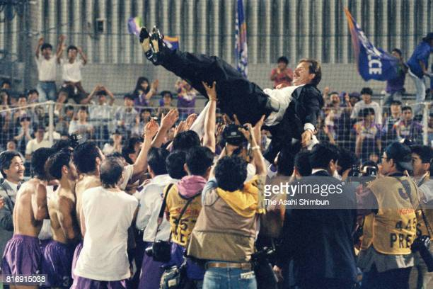 Safrecce Hiroshima head coach Stuart Baxter is tossed into the air by players as they celebrate the JLeague first stage champions after the JLeague...