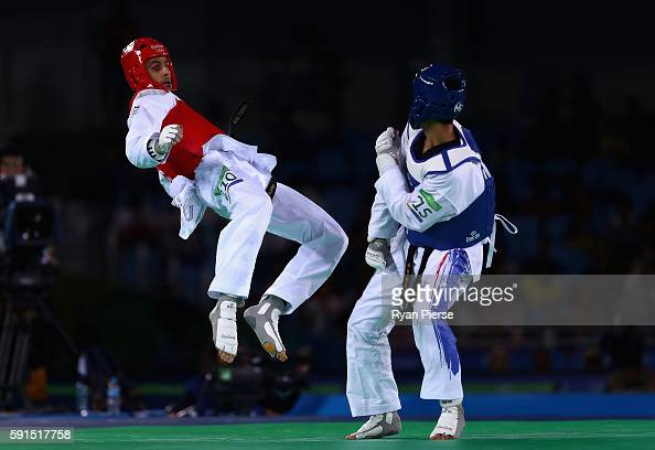Safwan Khalil of Australia kicks Tawin Hanprab of Thailand during the Taekwondo Men's 58kg Quarter Final contest at Cairoca Arena 3 on August 18 2016...