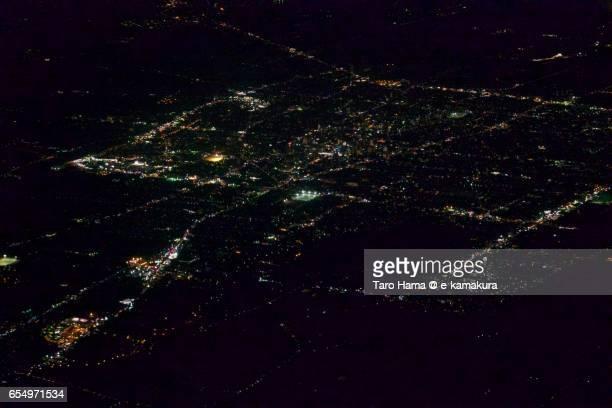 Saga city, night aerial view from airplane