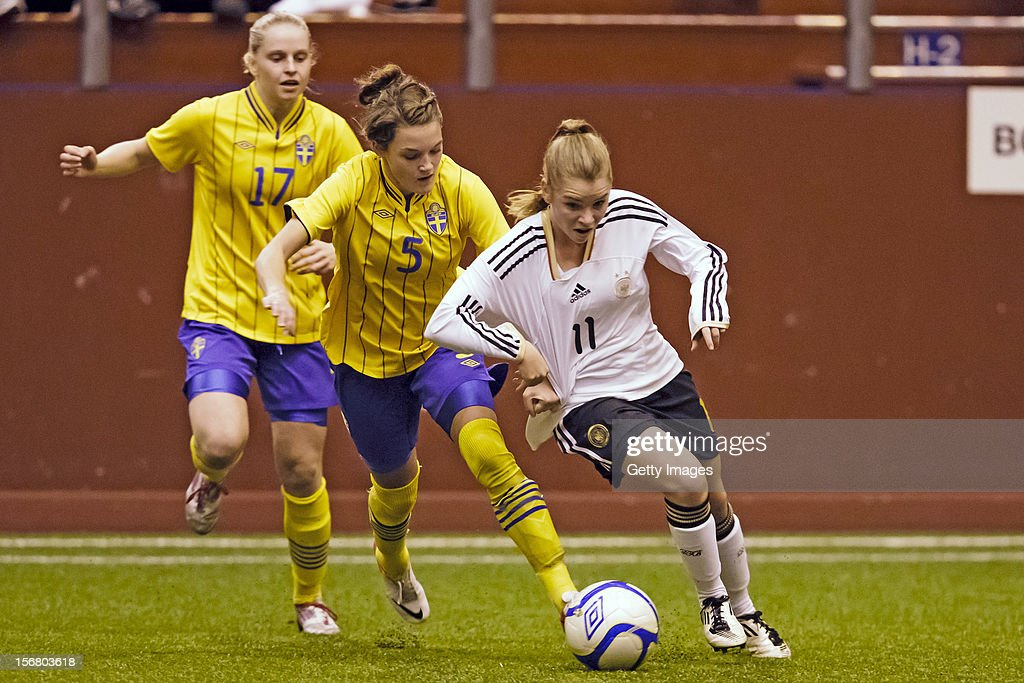 Saga Fredriksson of Sweden fights for the ball with Linda Dallmann of Germany during the Under 19 Women's international friendly between Sweden and Germany at Tipshallen Stadium on November 21, 2012 in Vaxjo, Sweden.