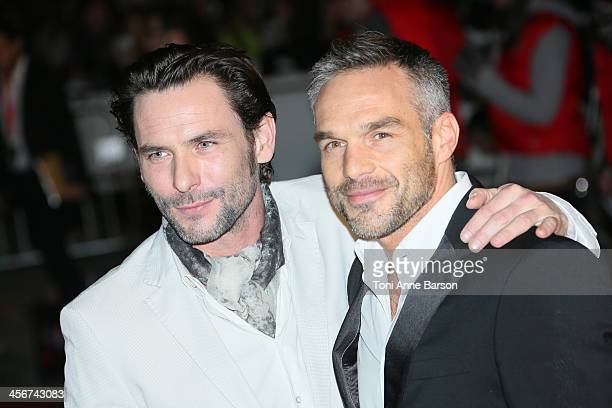 Sagamore Stevenin and Philippe Bas arrive at the 15th NRJ Music Awards at the Palais des Festivals on December 14 2013 in Cannes France